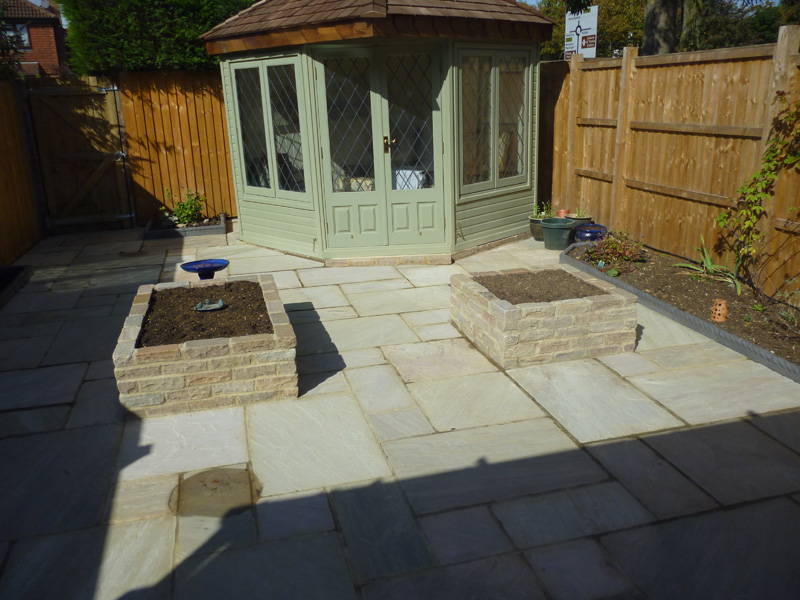 We replaced the tired lawn with a new patio featuring Bradstone Heather Ridge Sandstone paving