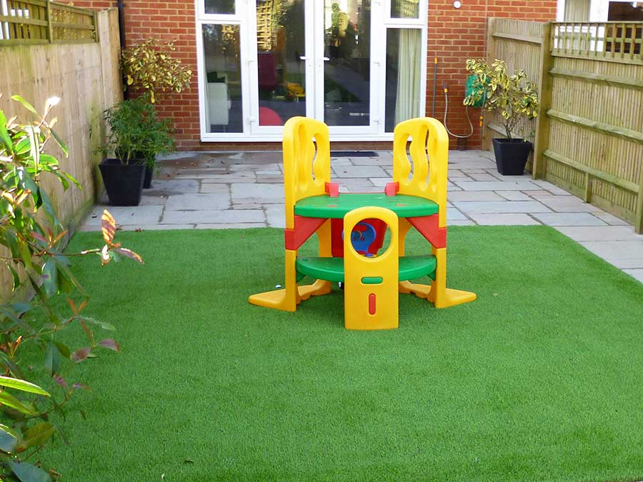 Artificial turf provides a safe place for young children to play in the garden by AWBS
