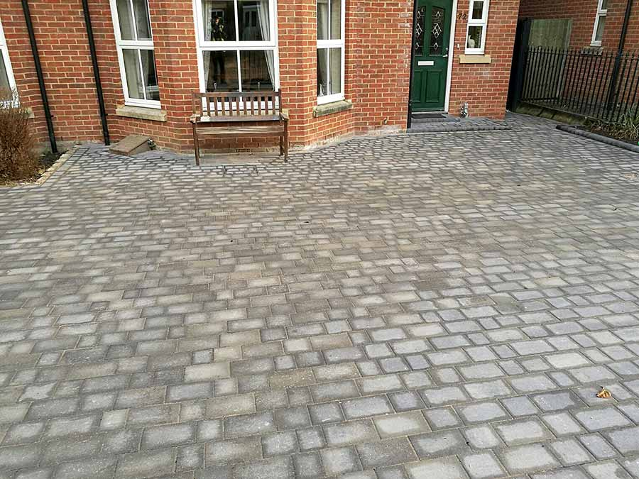 Block paving cut and shaped around the bay window of this property in Oxford by AWBS Landscaping