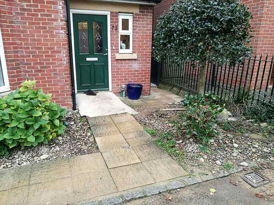 The paved paths to the two properties were tired and the shrubs had become overgrown and were both removed by AWBS Landscaping