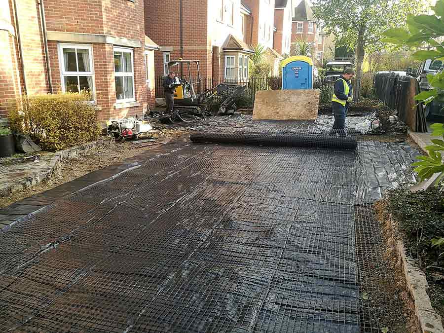 The AWBS Landscaping team installing weed control membranes for the foundations of the new block paved driveway