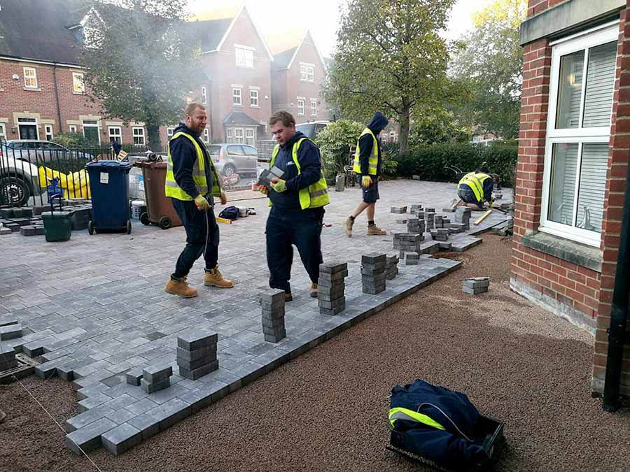 The AWBS landscaping team in the process of installing Brett Beta Trio block paving for this large new shared driveway in Oxford