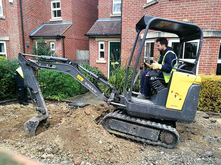 Digging out the site of the old driveway, paths and shrubs in preparation for laying the foundations for the new driveway