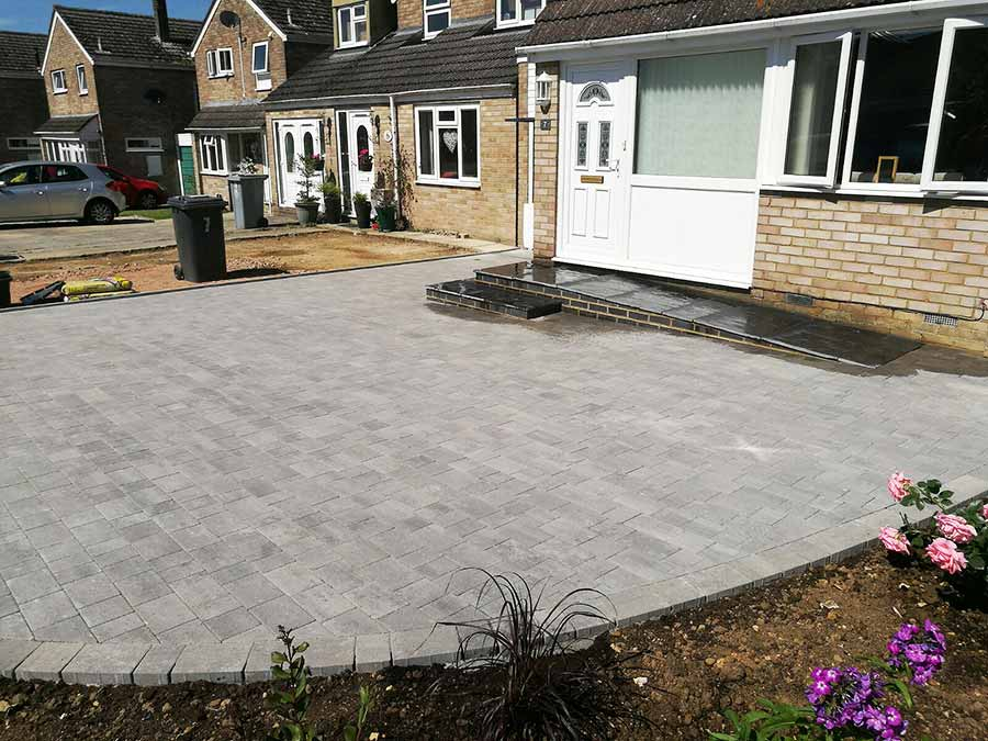 New and enlarged driveway with new drainage and ramp to the front door in Brett Beta Trio block paving of Silver Haze colour in OX29 Oxford